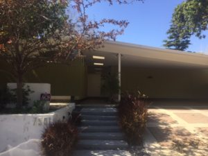 This house front shows how the carport became a distinct feature during the mid-century era.